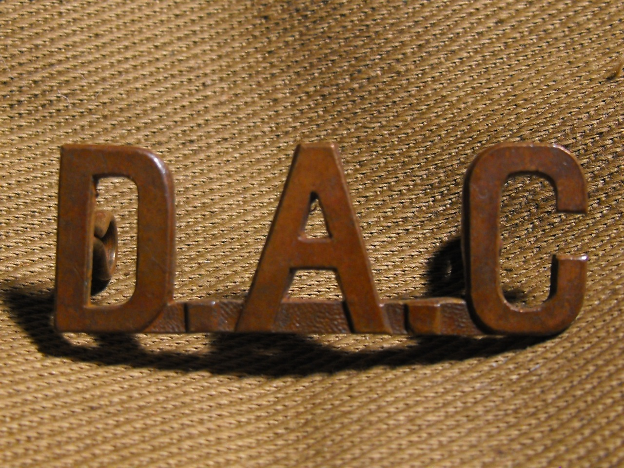 DAC Shoulder Title